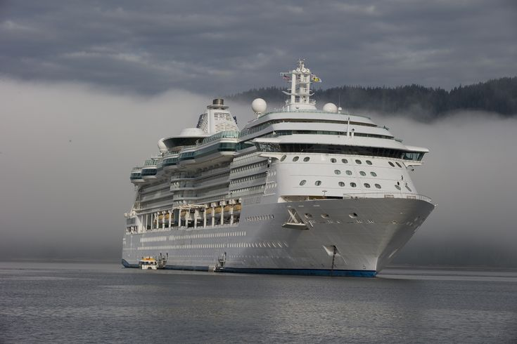 The fog rolls out around Radiance of the Seas.