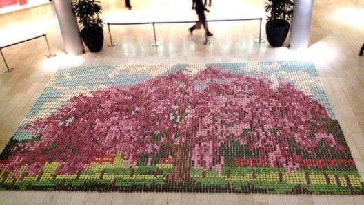 This ginormous mosaic was created by Crumbs and Dollies, a cake shop in London, for a Japanese television program ITTEQ. The mosaic was displayed at the Highcross Shopping Centre at Leicester.