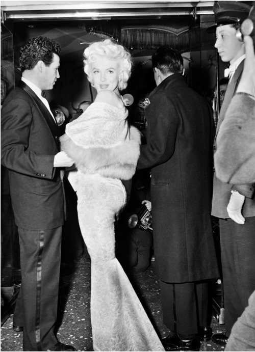 "Marilyn Monroe at the Astor Theatre for the benefit premiere of ""East of Eden."" Marilyn served as an usherette. The proceeds went to the Actors' Studio. Date- March 9th 195"