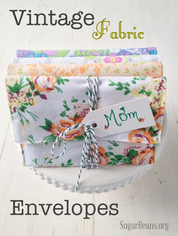 Vintage fabric envelopes filled with note cards. Good idea for Christmas!