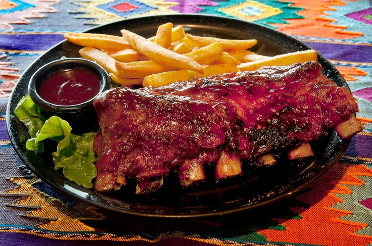Baby Back Ribs 1/2 Rack. Fall off the bone ribs finished over an open ...