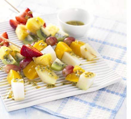 Frozen fruit sticks with passion fruit & lime drizzle