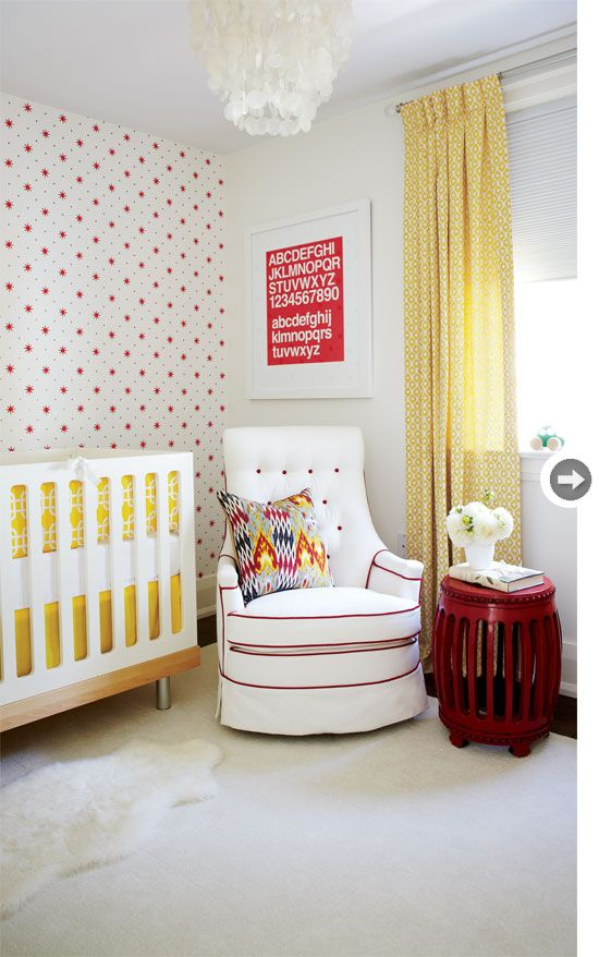 Adorable gender neutral nursery in red, yellow and white. Love the star print wallpaper.
