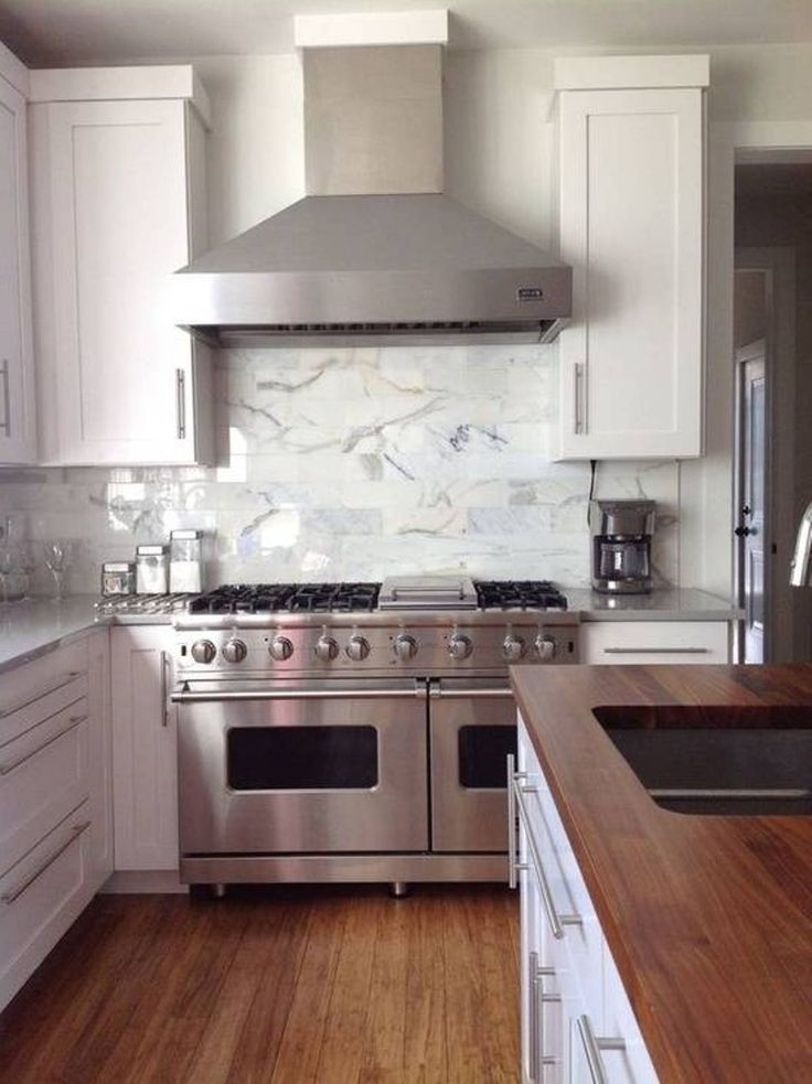 Kitchen With White Cabinet Silver Stove White Patterned Tile
