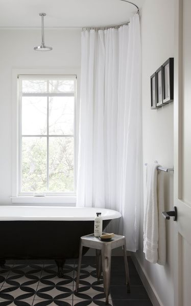 Something I love... going extra HIGH with the shower curtain. Makes the ceilings seem so much higher!  -Mara