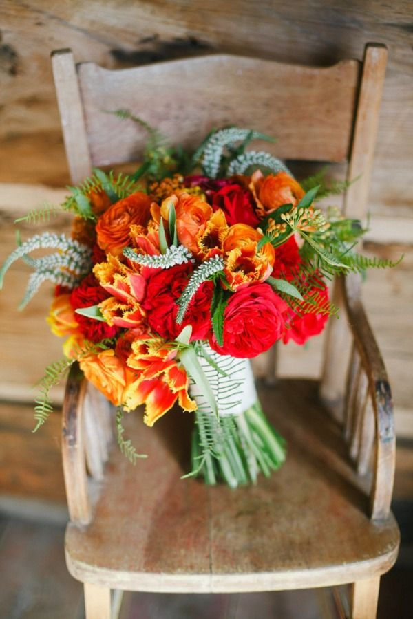 vibrant bouquet full of reds and oranges.