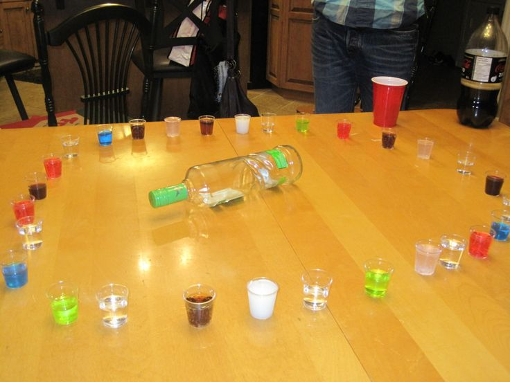 Shot Roulette. Not all the shots are alcoholic, spin the bottle and take what you get!   THIS COULD BE FUN!!!