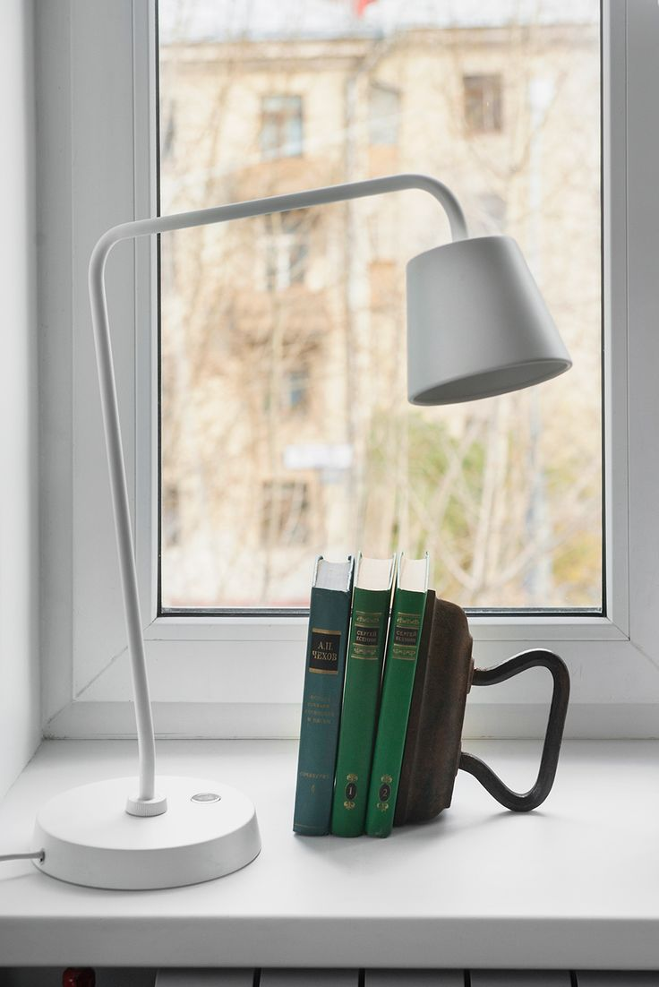 Compact Bachelor Haven in Moscow Defined by the Mix of Modern with Retro - love the vintage iron book holder