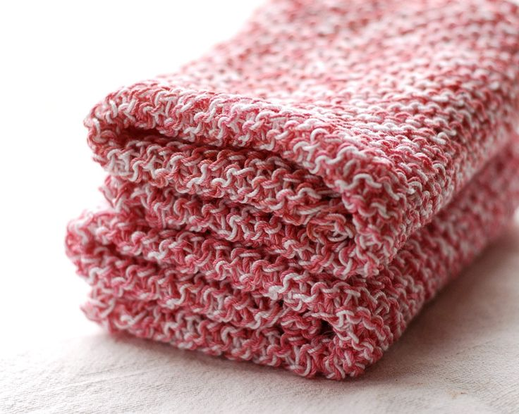 Knit dishcloth with two strands of crochet cotton.