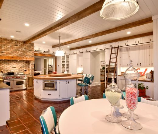 Transitional U shaped Burnt Orange kitchen, white cabinets, New York