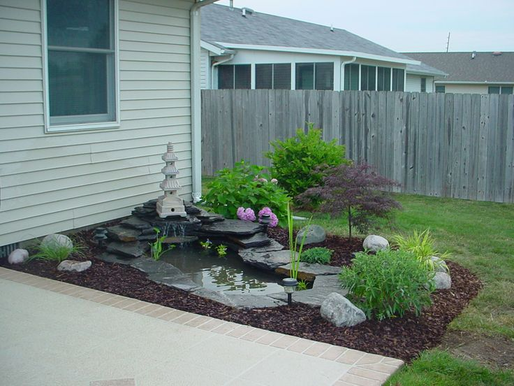 Small koi pond garden pinterest for Koi fish pond design