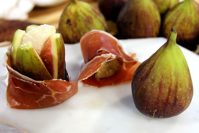fig stuffed with aged goat cheese, and the stuffed fig is wrapped ...