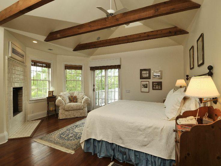 Beams in bedroom w 39 s master boudoir pinterest for Vaulted ceiling exposed beams