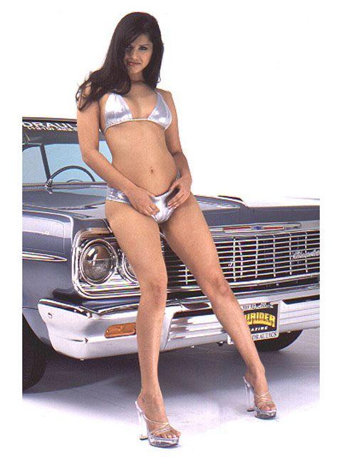 Sunny Leone Leaning Against Car In A Silver Bikini