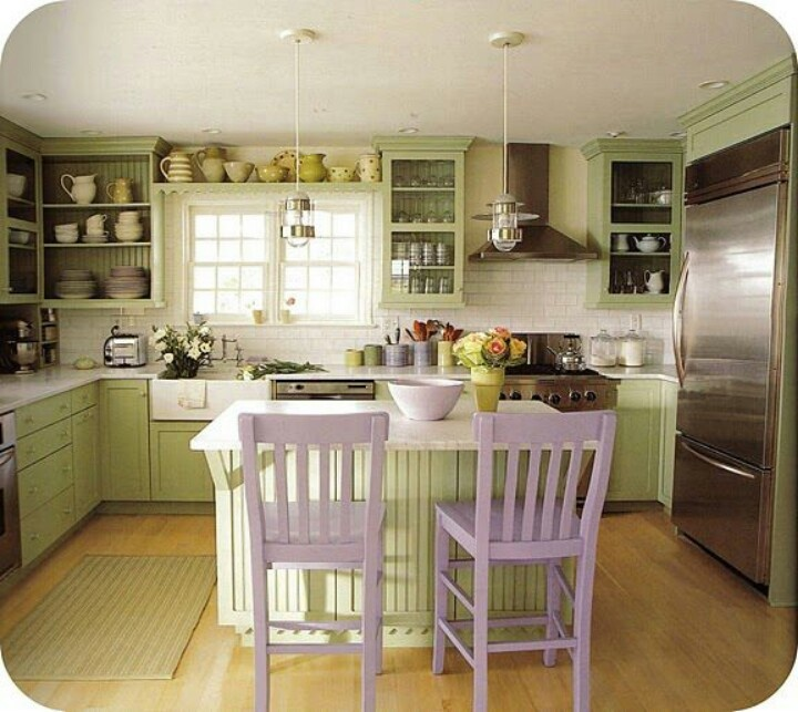 green kitchen with white subway tile walls