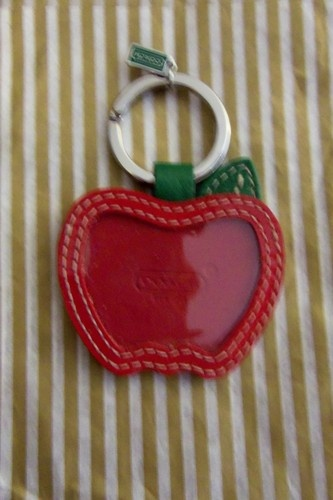 Coach big red apple keyfob new is going up for auction at 6pm wed