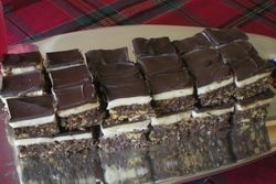nanaimo bars: three layers of sweetness that include coconut flakes ...