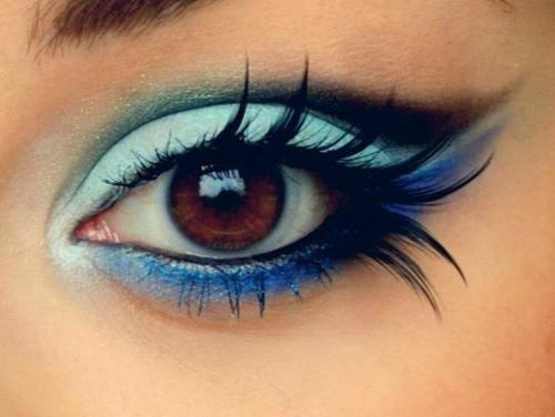 blue eye makeup with fake eyelashes. beautiful