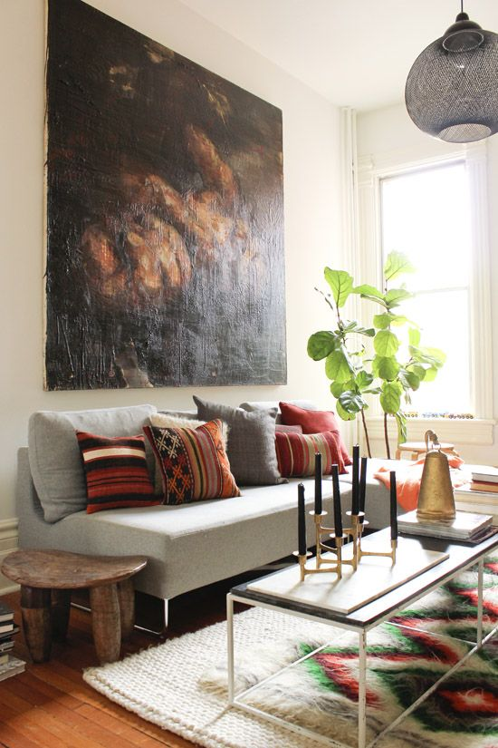 layered rugs and oversized art