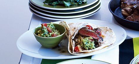 steak (or chicken) fajitas with tomato and lime