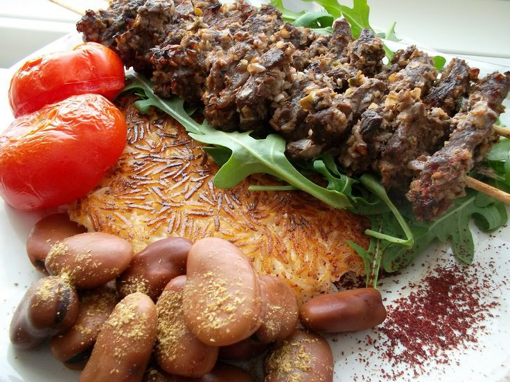 ... marinated in a paste made of crushed walnuts, pomegranate juice or