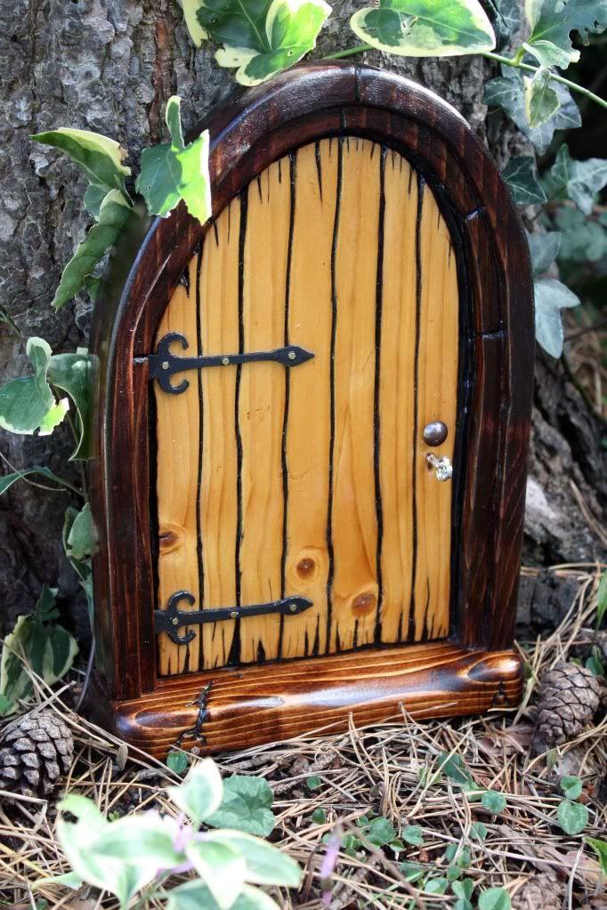 Fairy door fairy hobbit houses pinterest for Fairy doors images