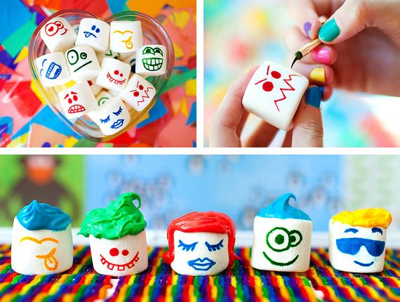 Super cute marshmallow faces made using food coloring and a paintbrush