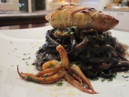 Spicy Squid Ink Linguini with Sausage Stuffed Calamari. (no recipe)