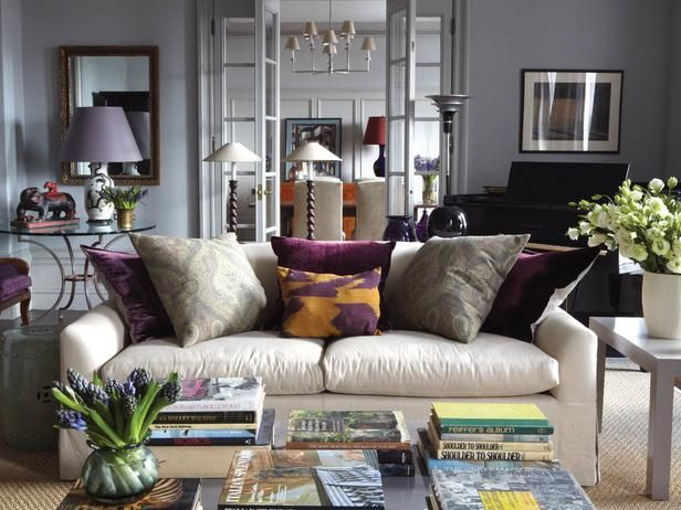 Shades of purple are echoed throughout this formal living room -- from the royal purple throw pillows, to the armchair, lampshade and the vase of hyacinth -- for a contemporary touch.