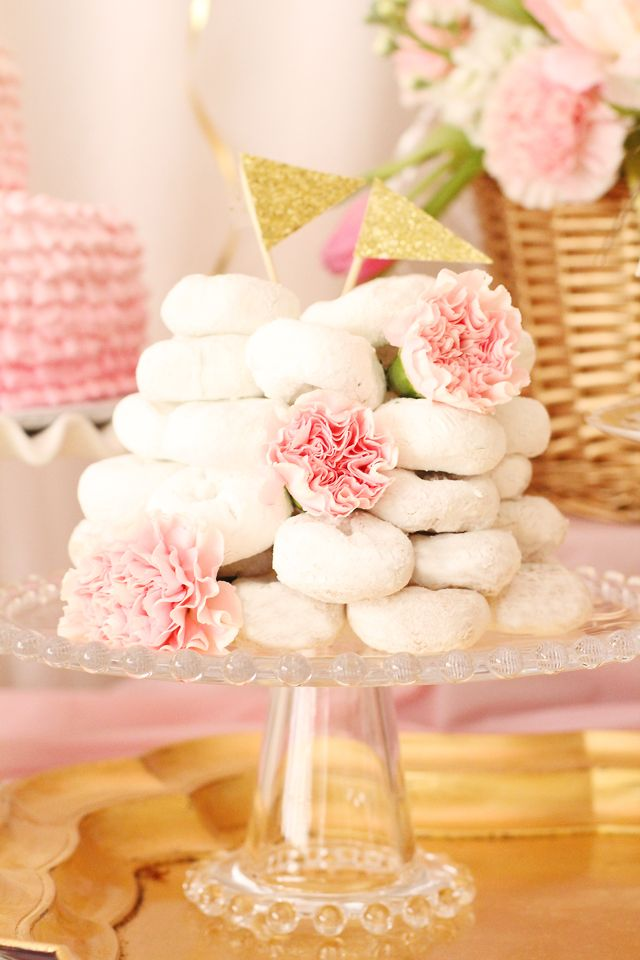 A white donut tower not only looks amazing, it serves as great #partyfood for a morning party! #partyidea