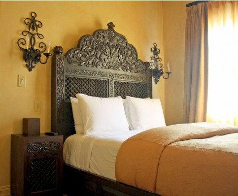 Spanish style carved headboard with dark walnut finish for Spanish style bed