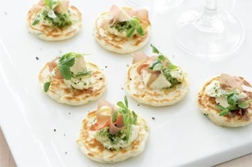 Cheese and chive blini with pesto cream & prosciutto