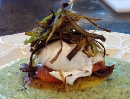 poached egg presented on a seared polenta cake with apple smoked bacon ...
