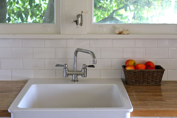 subway tile backsplash butcher 39 s block counter and apron front sink