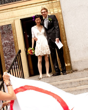 Bride with a cute pixie cut and a short wedding dress