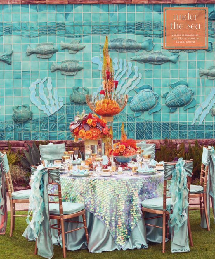 Teal under the sea wedding table linens. @sondraburnham - check out the table cloth,looks like a mermaid