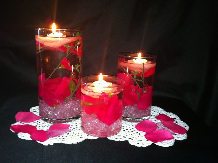 Elegant wedding centerpiece pink flowers submerged in