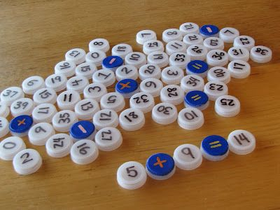 water bottle lids..Great idea for a math center!