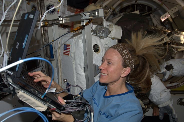 Handmade headband - keeps the velcro on the walls and equipment of Space Station from sticking to my pulled back hair! This one for my dog and all the others that make their people so happy!  KN from space.