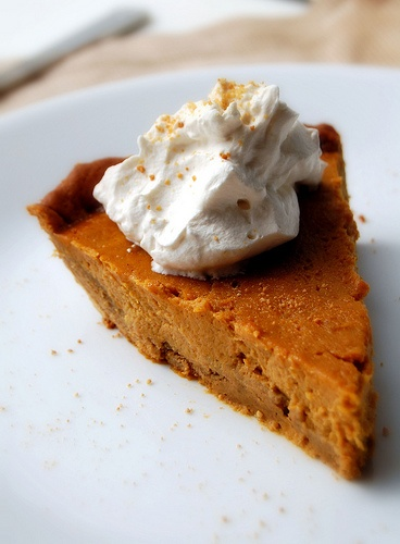 Chewy Ginger Cookie-Crusted Pumpkin Pie with Maple Whipped Cream