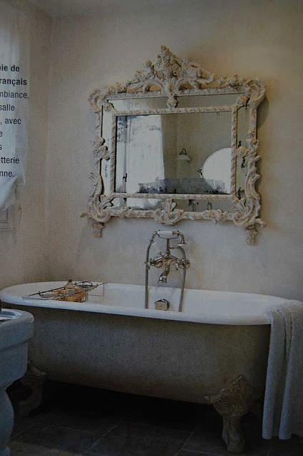 awesome antique mirror in a bathroom