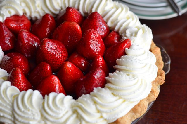 ... pie filled with fresh strawberries and crowned with whipped cream