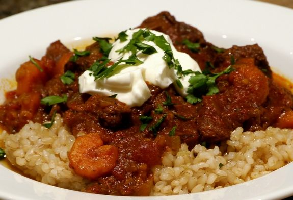 Slow-Cooker Beef & Tomato Stew over brown rice...this looks really ...