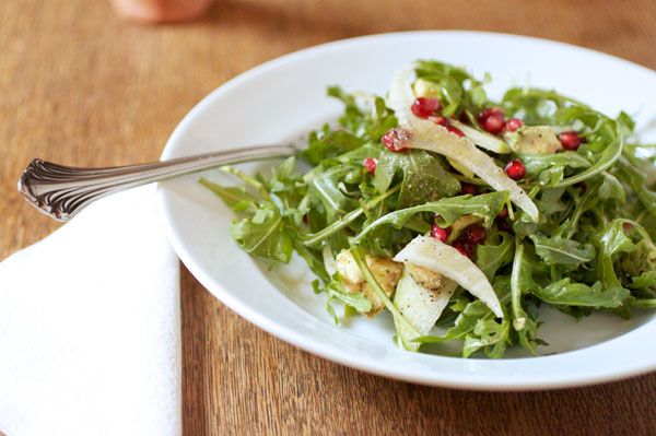 Pomegranate in winter salad with arugula, fennel, avocado, apples ...