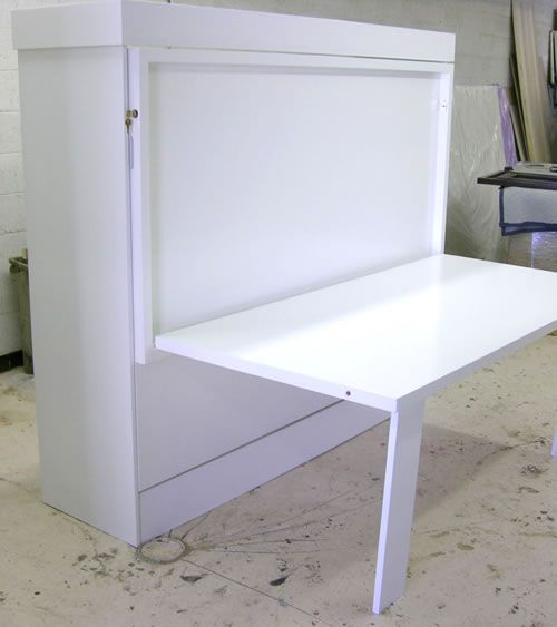 Murphy bed with folding work table for rooms that double as office and