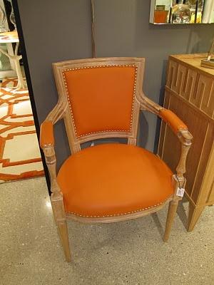 Vivid orange leather on a louis xvi chair