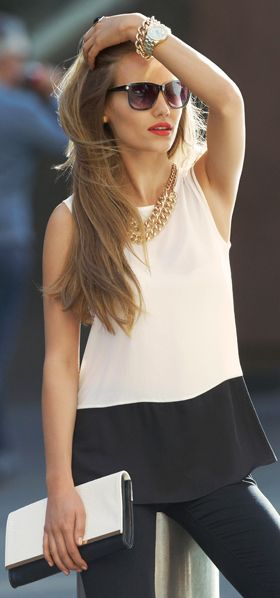 Black and white color block sleeveless shirt, black pants, chunky gold necklace and jewelry; work outfit - fall / winter