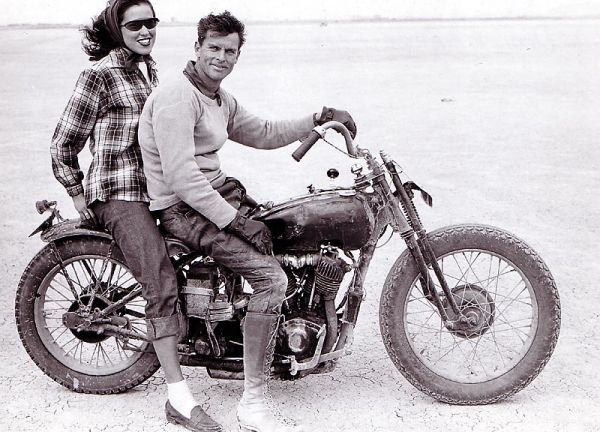 """""""Don & Marge Fera, 1940s. Back then, race bikes had hand-shifters, metal number plates and if your gal had nerve she showed just a hint of leg."""" –caption by Dean Adams"""
