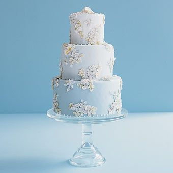 True Blue. A brocade of tiny handmade sugar flowers and crystals adorn this three-tier cake in three shades of robin's egg-blue fondant. By Polly's Cakes via Brides.