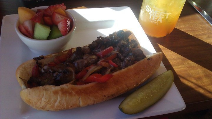 """ Cheese Steak: seasoned shaved filet mignon, piled high w/ grilled ..."